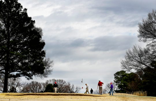 Golfers take part in a seniors tournament at Audubon Golf Course.