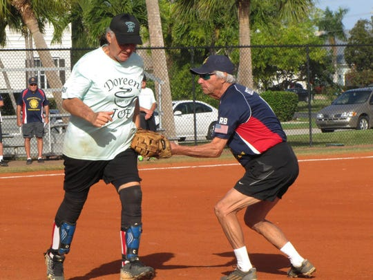 Al Bozzo, American Legion Post first baseman, puts the tag out on Angelo Polizzi of Doreen's.