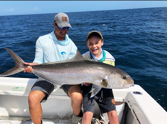 Trey Hill, age 13, used aove pin fish to hook this Amberjack off the coast of Naples.