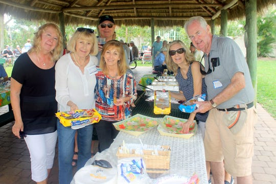 Serving the cookies are Bobbie Ordejia, Virginia Buingle, John Rafes, Sandi Friend, Pat Arcidiacono and Tom Moran.