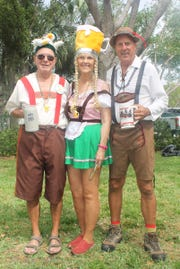 Dave and Susie Walsh and Dale Rod are ready for Febrewfest.