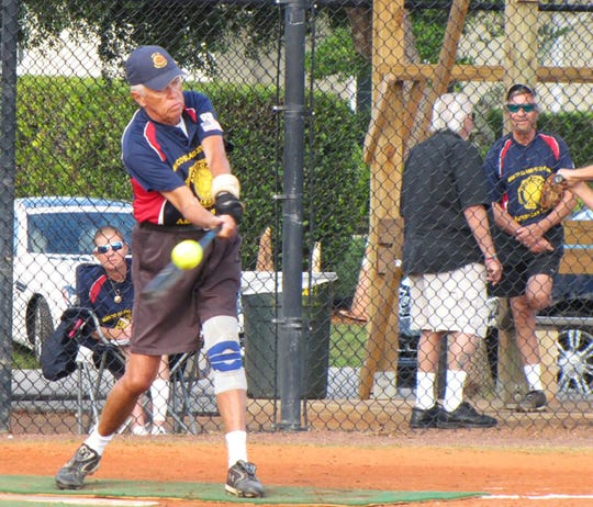 American Legion Post Bill Diamond drives the ball for a base hit and a RBI in game against Doreen's.