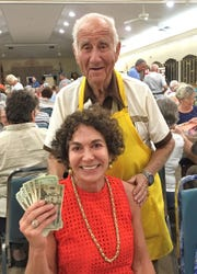 Sandi Stern, with Bingo committee member Dr. Herb Kern, was the big winner at Monday Night Bingo held every week at the Jewish Congregation of Marco Island.