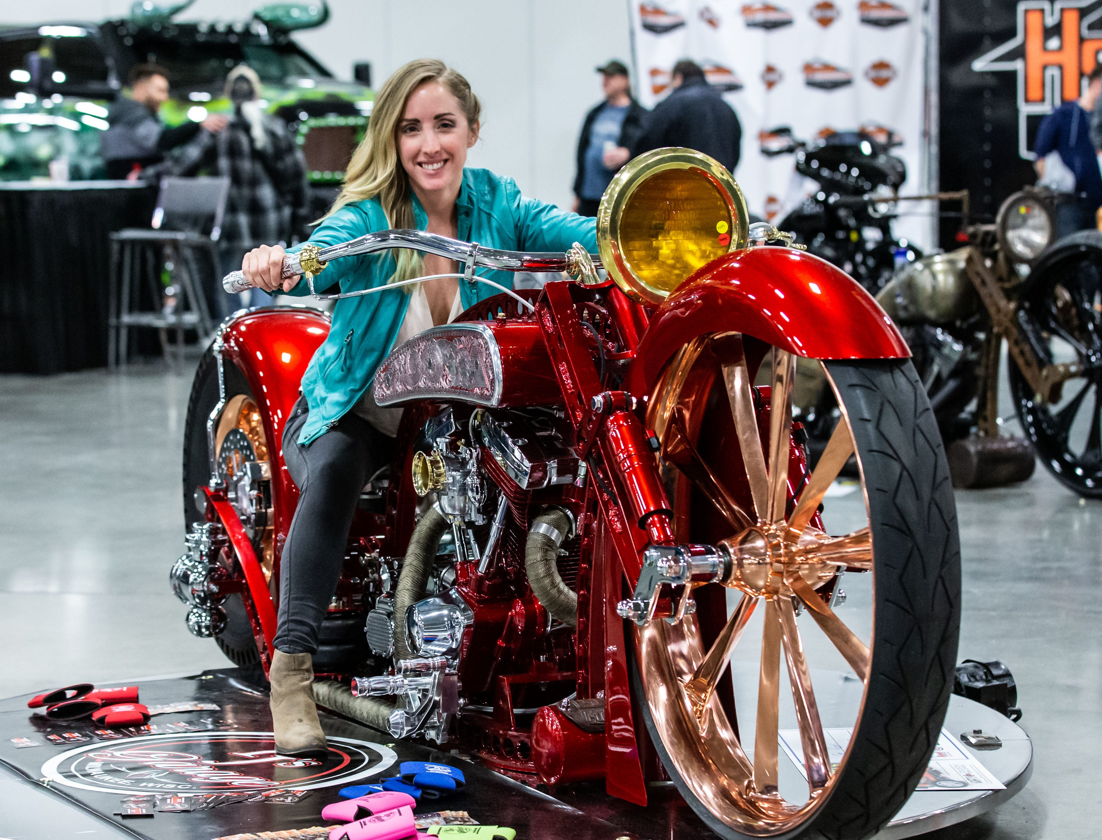 Abby Sielaff of Lake Mills checks out a 2018 Big Wheel from PJ's Custom Garage of Milwaukee during the 57th annual O'Reilly Auto Parts World of Wheels at State Fair Park in West Allis on Saturday, Feb. 23, 2019. The event features over 300 vehicles, celebrity appearances, vendors, a charity auction and more.