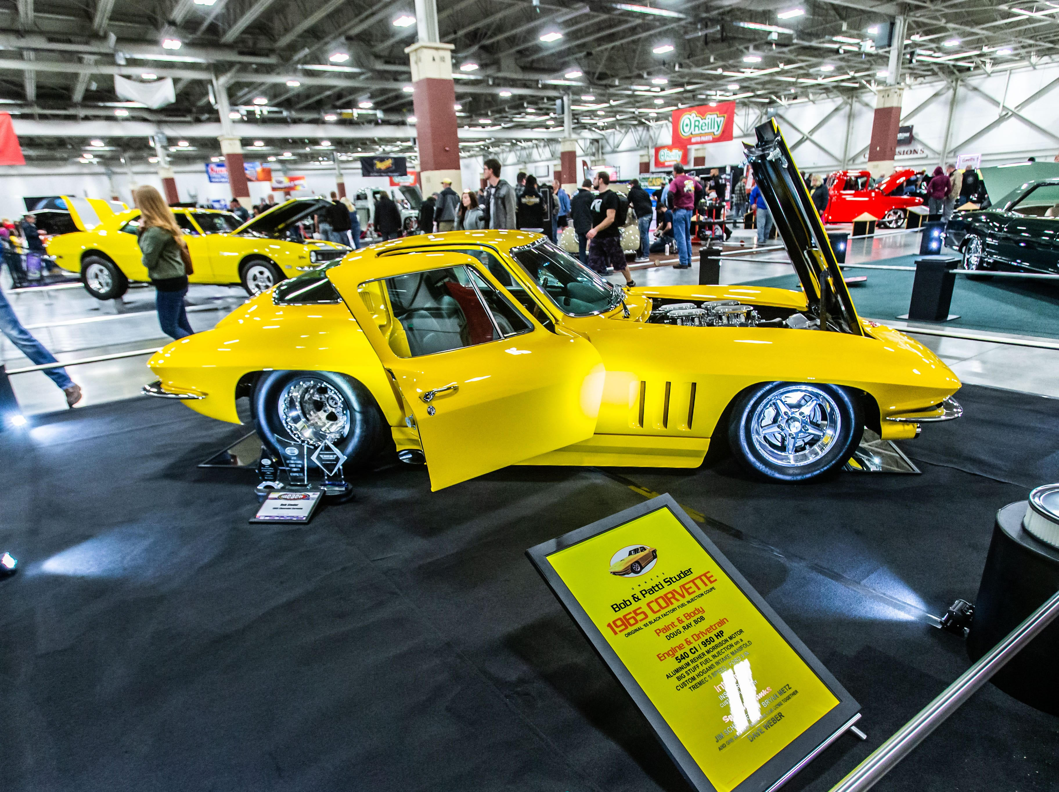 Car show enthusiasts enjoy the world class craftsmanship on display during the 57th annual O'Reilly Auto Parts World of Wheels at State Fair Park in West Allis on Saturday, Feb. 23, 2019. The event features over 300 vehicles, celebrity appearances, vendors, a charity auction and more.