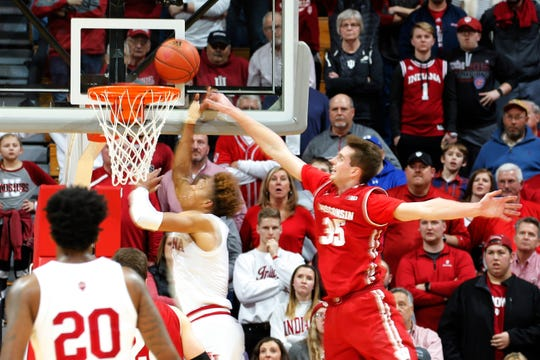 Indiana Hoosiers guard Romeo Langford scores the game-winning basket despite the outstretched arm of Nate Reuvers with 0.8 seconds left in the second overtime.