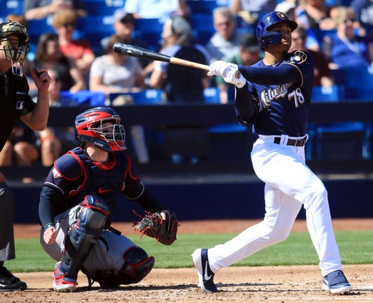 Corey Ray hits a solo home run during the third inning of the Brewers' spring training game against the Indians on Wednesday.