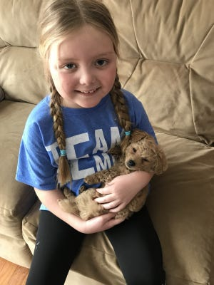 Emma Mertens is a terminally ill 7-year-old receiving dog letters from across the country.