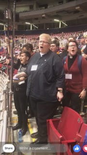 The Rev. Amy DeLong of River Falls United Methodist Church (center) takes part in a protest Tuesday at the United Methodist Church's General Assembly in St. Louis. DeLong, who is gay, was among those objecting to the assembly's vote to uphold the church's ban on gay clergy and gay marriage.