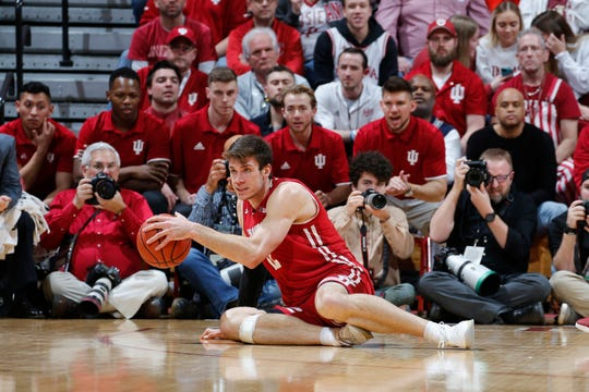 Wisconsin forward Ethan Happ finds himself in an awkward position against Indiana on Tuesday night at Assembly Hall.
