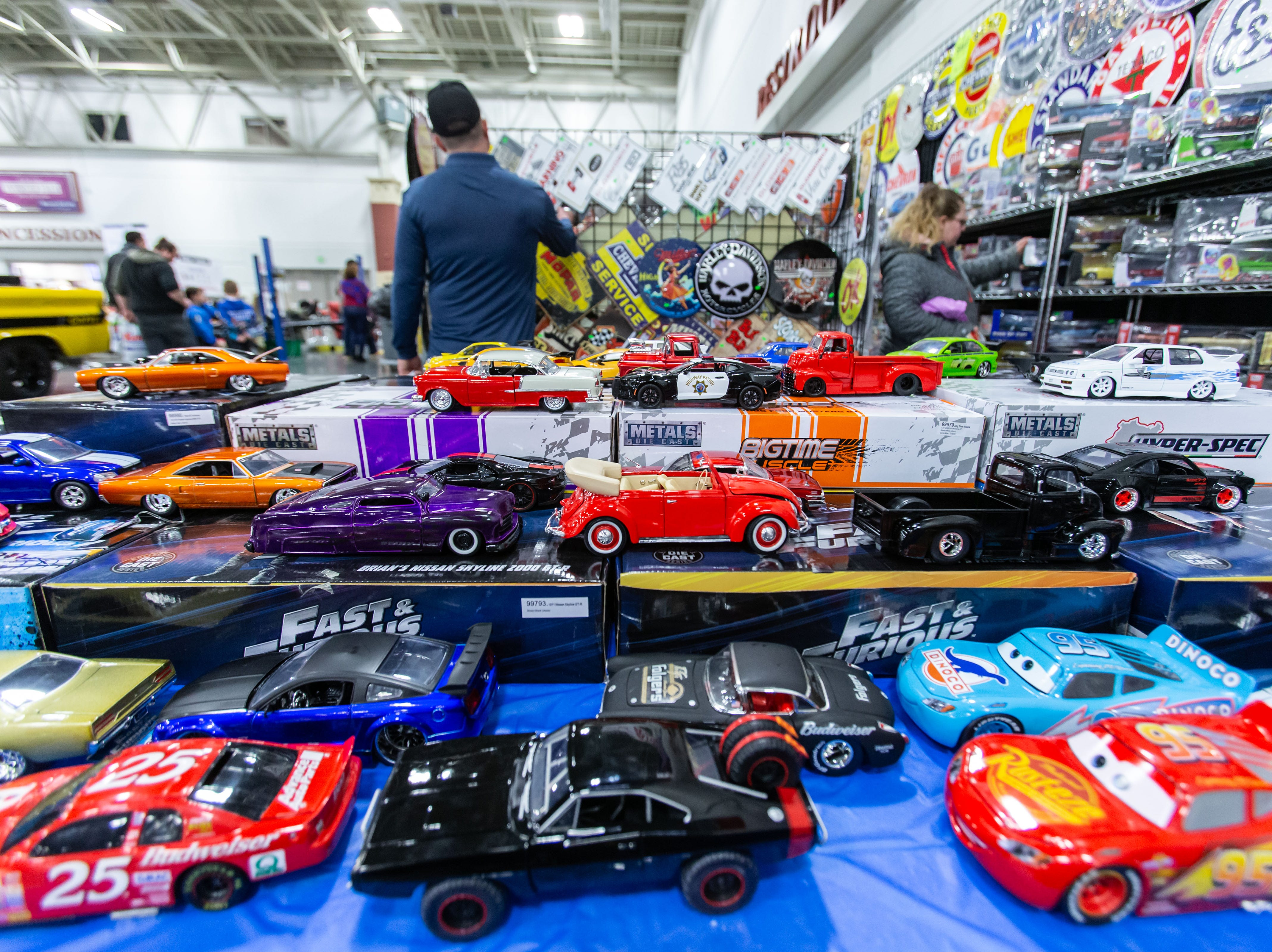 Visitors browse a wide variety of model cars and signage offered by Model Empire of West Allis during the 57th annual O'Reilly Auto Parts World of Wheels at State Fair Park in West Allis on Saturday, Feb. 23, 2019. The event features over 300 vehicles, celebrity appearances, vendors, a charity auction and more.