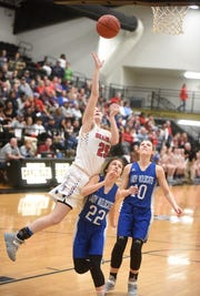 Melbourne's Dani Hardaway draws a foul against Hector on Tuesday at Carlisle.