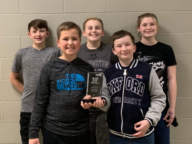 A team representing the Mountain Home Quiz Bowl Club took home the championship ofthe Washington Middle School Invitational Tournament held Saturday in Washington, Mo. Members of team are: (from left)Orion Reuscher, Jack Coleman, Aidan Shrable, Declan Whitlockand Lilly Higle.