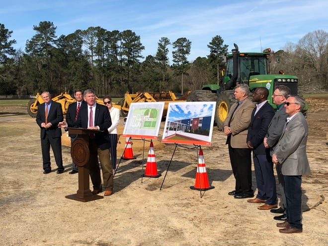 Pike Road Schools District officials and city officials meet at a groundbreaking ceremony for a new athletic facility on Monday, Feb. 25.