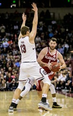 Feb 26, 2019; Columbia, SC, USA; Alabama Crimson Tide guard Riley Norris (1) looks to pass around South Carolina Gamecocks forward Felipe Haase (13) in the second half at Colonial Life Arena. Mandatory Credit: Jeff Blake-USA TODAY Sports