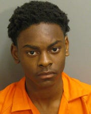 Michael Woods was charged with possessing a firearm on a school campus and attempted murder.