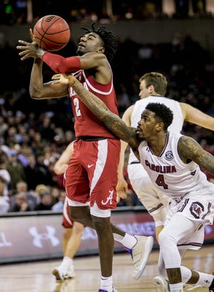 Feb 26, 2019; Columbia, SC, USA; Alabama Crimson Tide guard Kira Lewis Jr. (2) is fouled by South Carolina Gamecocks guard Tre Campbell (4) in the second half at Colonial Life Arena. Mandatory Credit: Jeff Blake-USA TODAY Sports