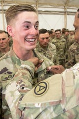 CAMP BUEHRING, Kuwait – Army Pfc. Daniel Gray, a paralegal specialist assigned to the Area Support Group-Kuwait, U.S. Army Central, was awarded the Air Assault Badge on day ten of Air Assault School's Class 301-19, Feb. 15, 2019, at Camp Buehring, Kuwait. Soldiers currently serving in U.S. Army Central's area of operations earned the Air Assault Badge after developing additional skills, including moving equipment and rappelling, to benefit their unit while forward deployed. (U.S. Army Reserve photo by Sgt. Christopher Lindborg)