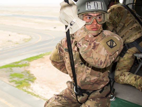 CAMP BUEHRING, Kuwait – Army Spc. Christopher Michael, assigned to the 150th Brigade Engineer Battalion, Mississippi Army National Guard, prepares to rappel out of a Black Hawk helicopter on day nine of Air Assault School's Class 301-19, Feb. 14, 2019, at Camp Buehring, Kuwait. Conducting hands-on training in U.S. Army Central's area of operations in a Black Hawk helicopter gives Soldiers the opportunity to develop additional skills, including moving equipment and rappelling, to benefit their unit while forward deployed. (U.S. Army Reserve photo by Sgt. Christopher Lindborg)