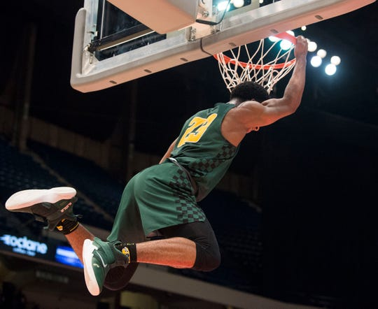 Carver's Michael Murry (23) dunks the ball during the Class 6A state semifinal at Legacy Arena in Birmingham, Ala., on Wednesday, Feb. 27, 2019. Carver defeated Muscle Shoals 62-47.