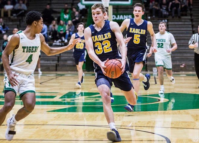 Delta's Brady Hunt scored 20 points and pulled down 10 rebounds in a win over Yorktown in the sectional opener.