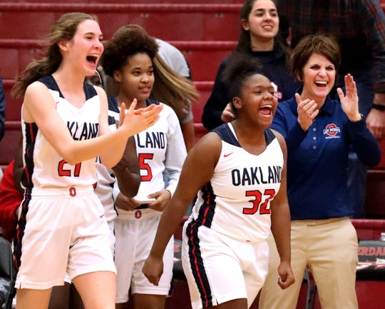 Oakland's Jane Cluff (21), Janiyah Riley (15), Erykah Collier (32) and Oakland's head coach Jennifer Grandstaff all celebrate their 59-53 overtime victory in the Region 4-AAA Semifinal game, against Blackman, on Tuesday, Feb. 26, 2019.