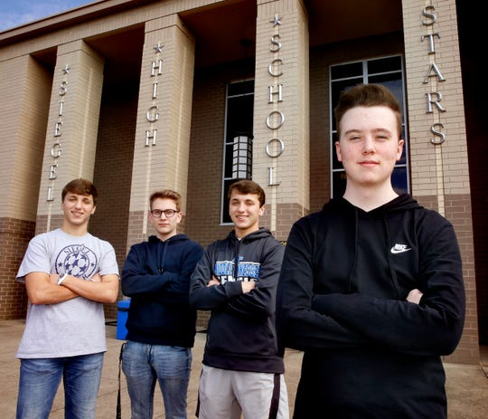 Siegel High School students (left to right) Ethan Summar, 17, Carter Hinson, 17, John Summar, 17 and Jay Watson, 17, all bonded together after Watson was injured in a skateboarding accident in August 2018. The boys stand in front of Siegel High School on Wednesday, Feb. 27, 2019.
