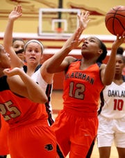 Blackman's Nia Vanzant (12) goes up for a shot during the Region 4-AAA Semifinal game against Oakland, on Tuesday, Feb. 26, 2019.