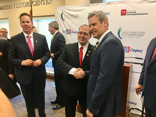 Dan Fachner, president and CEO of Icee, left, looks on as La Vergne Mayor Jason Cole, center, and Gov. Bill Lee shake hands. Icee announced it is moving its corporate headquarters from California to La Vergne.