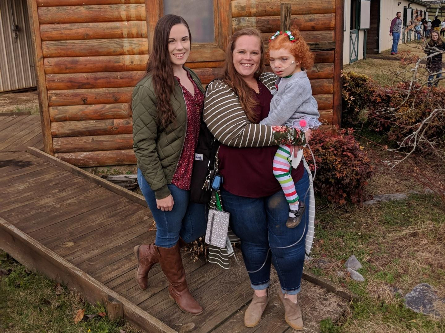 Tatum Gross, mom Michelle Gross and 6-year-old Asher Gross at the Small Miracles Therapeutic Horseback Center on Nov 25, 2018. Asher was born with severe disabilities, and Michelle, a single mom living in Jonesborough, Tenn., struggles financially to support her family and pay for the significant medical bills associated with her younger daughter's care.  Michelle Gross is advocating for a Medicaid pathway for children in Tennessee with severe disabilities living at home with their families.
