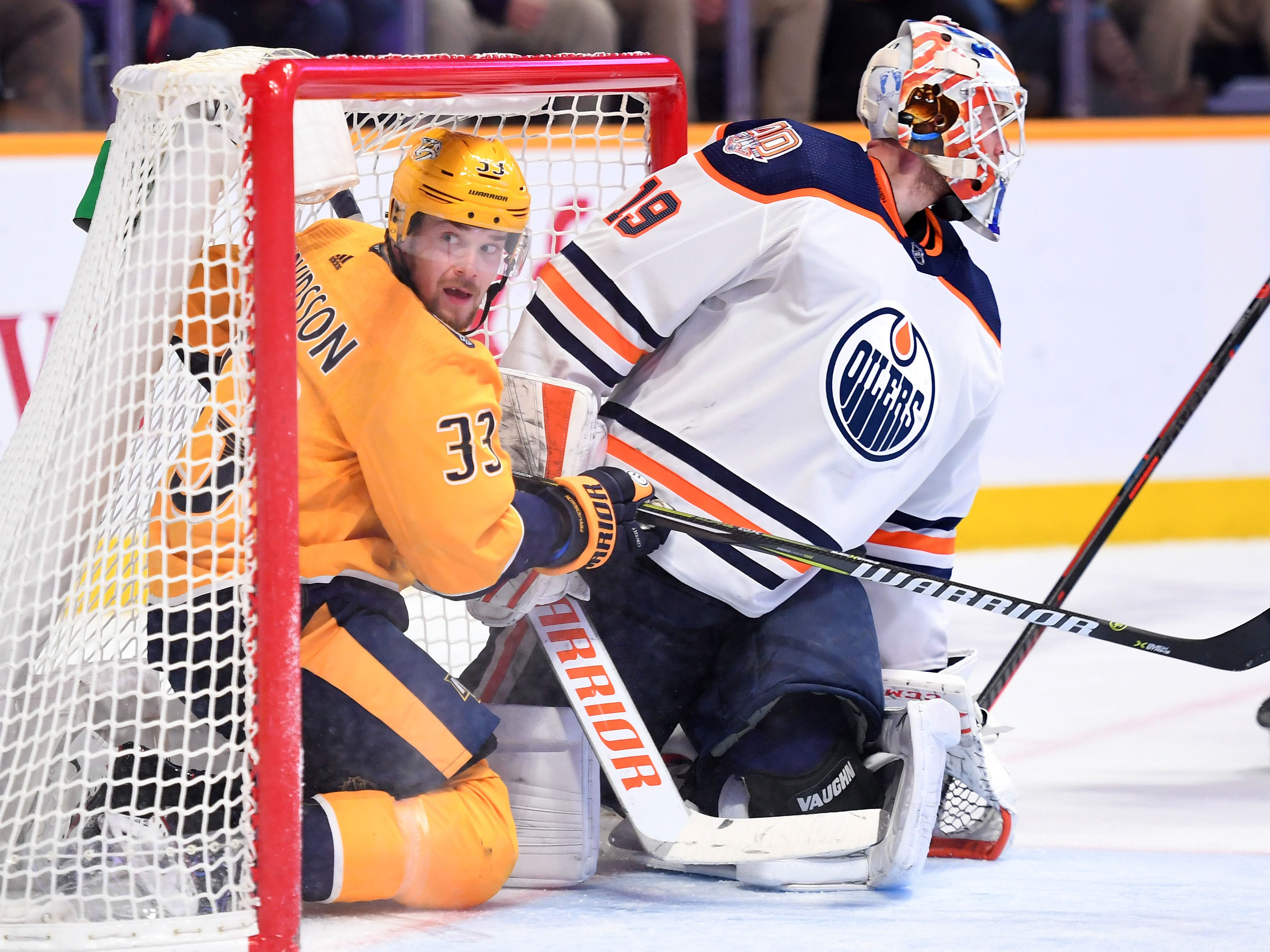 Nashville Predators right wing Viktor Arvidsson (33) looks to an official after being hit and crashing into Edmonton Oilers goaltender Mikko Koskinen (19) during the third period at Bridgestone Arena.