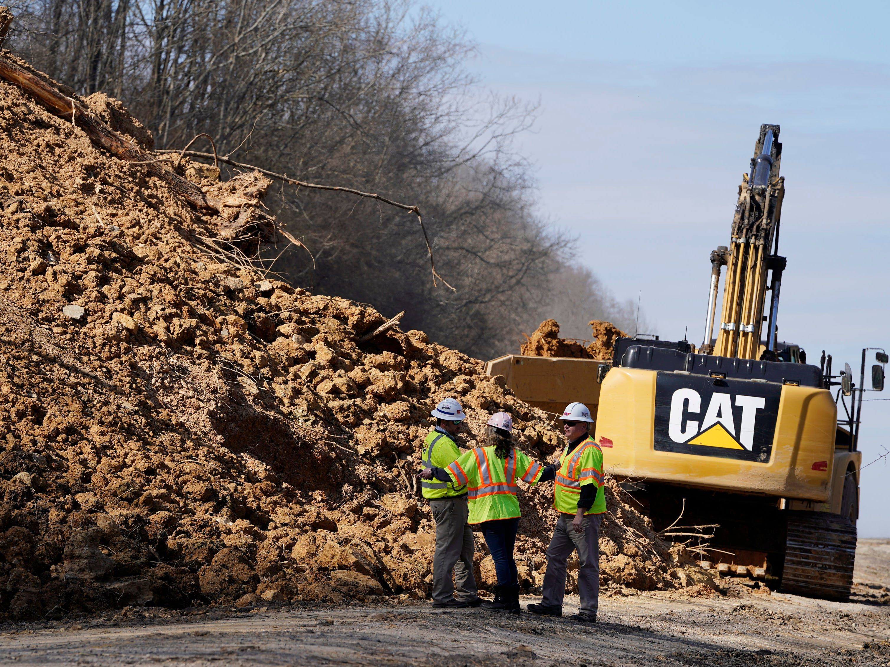 Tennessee Department of Transportation workers clean up debris from a landslide that occurred Saturday along I-24 eastbound near mile marker 42 in the Whites Creek area  Wednesday, Feb. 27, 2019 in Nashville, Tenn.