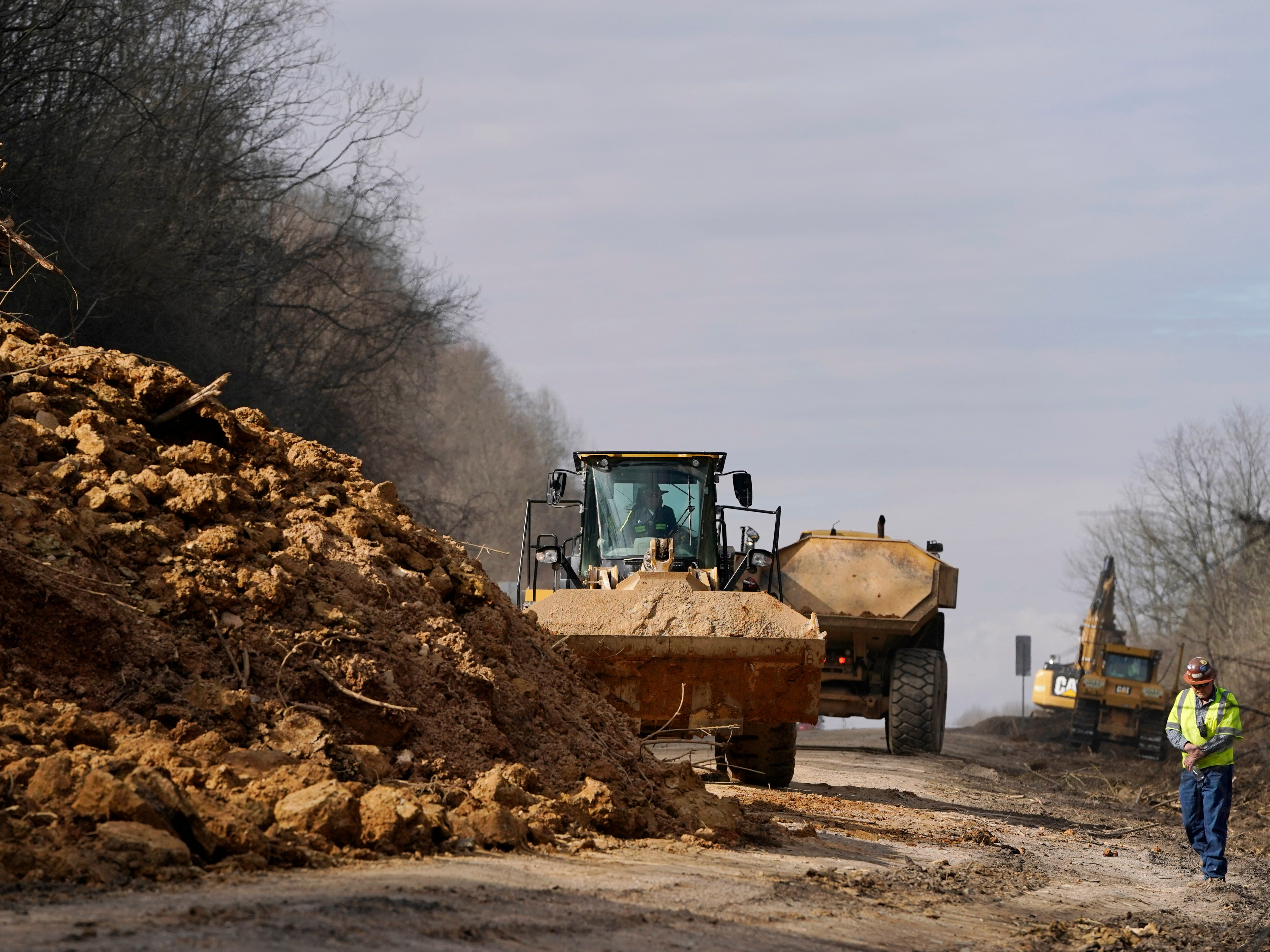 Tennessee Department of Transportation workers clean up debris Feb. 27, 2019, from a landslide along Interstate 24 eastbound near mile marker 42 in the Whites Creek area.