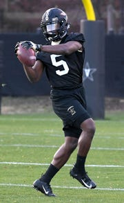 Vanderbilt cornerback Dontye Carriere-Williams runs a drill during the team's first spring practice on Wednesday.