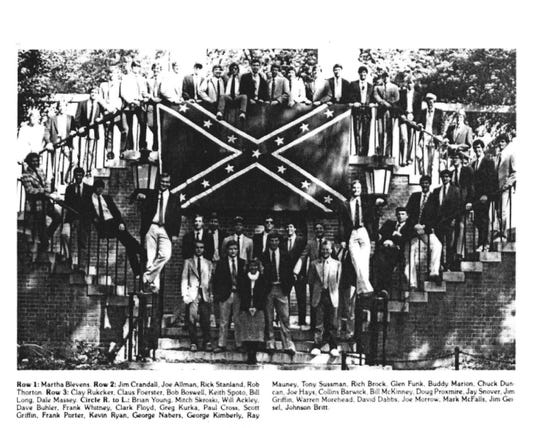 Nashville District Attorney Glenn Funk on Tuesday released a photo from his 1982 Wake Forest yearbook, The Howler, showing him posing with fellow Kappa Alpha fraternity members on a staircase in front of an over-sized Confederate battle flag.
