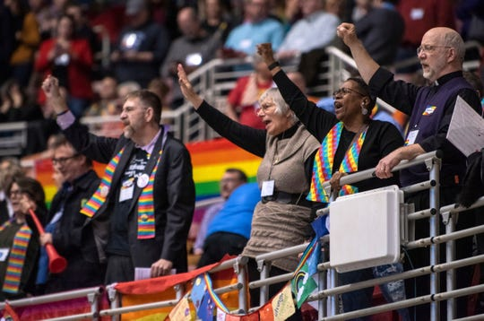 Protestors chant during the United Methodist Church's special session of the general conference in St. Louis, Tuesday, Feb. 26, 2019. America's second-largest Protestant denomination faces a likely fracture as delegates at the crucial meeting move to strengthen bans on same-sex marriage and ordination of LGBT clergy. (AP Photo/Sid Hastings)