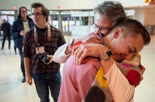 JJ Warren of New York embraces Julie Arms Meeks of Atlanta during protests outside the United Methodist Church's 2019 Special Session of the General Conference in St. Louis on Feb. 26, 2019. The United Methodist Church faces a likely surge in defections and defiance after delegates at a crucial conference voted to strengthen bans on same-sex marriage and ordination of LGBT clergy.