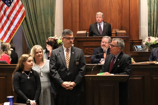 Left, Dickson County Sheriff Jeff Bledsoe and his family is recently honored by, right, state Sen. Kerry Roberts in the state Senate.