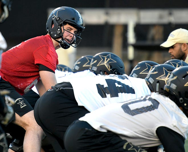 Former Ball State quarterback Riley Neal makes a call during Vanderbilt's first spring practice on Feb. 27, 2019.