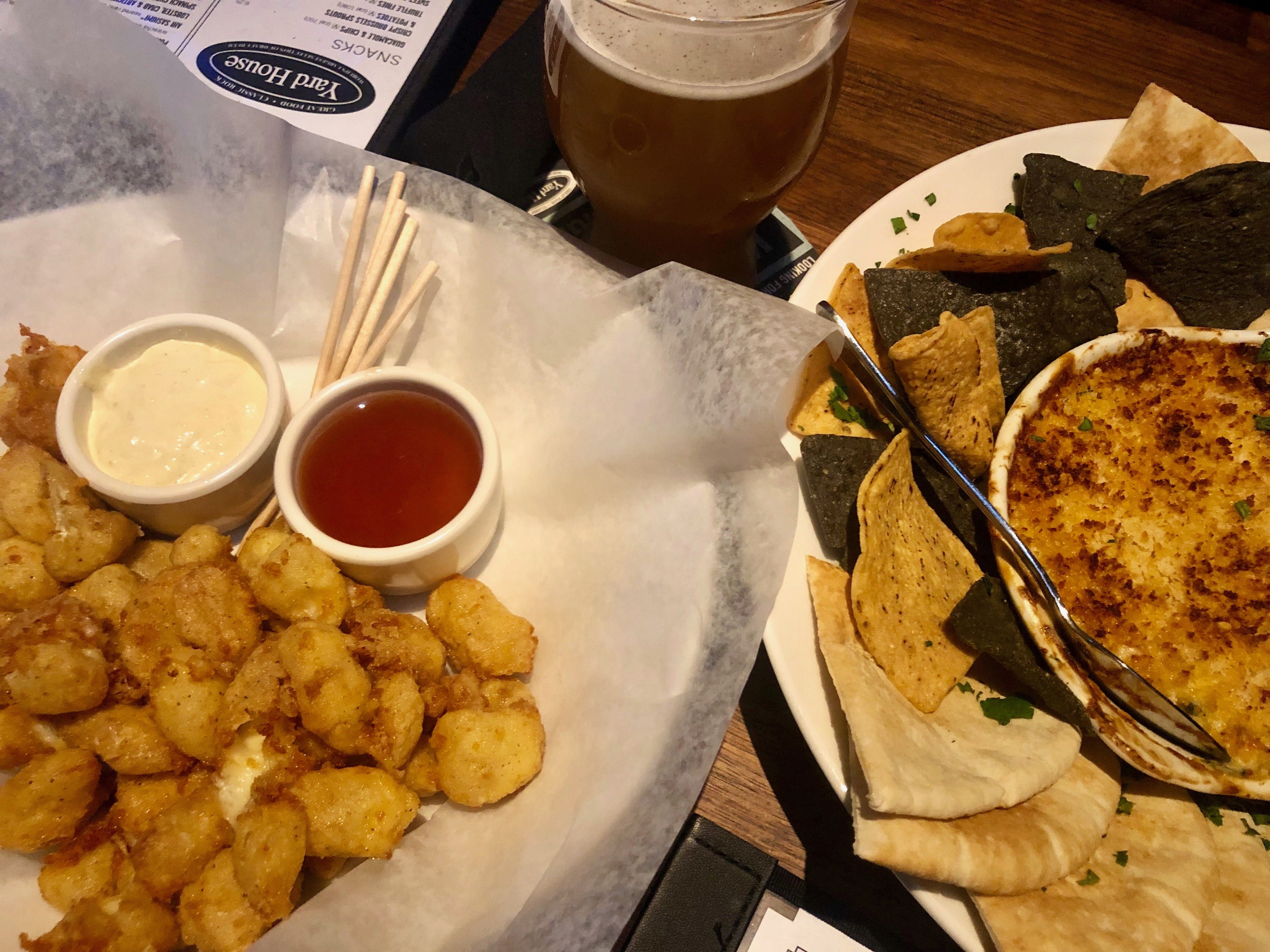 Wisconsin cheese curds and lobster, crab and artichoke dip from Yard House in Naples
