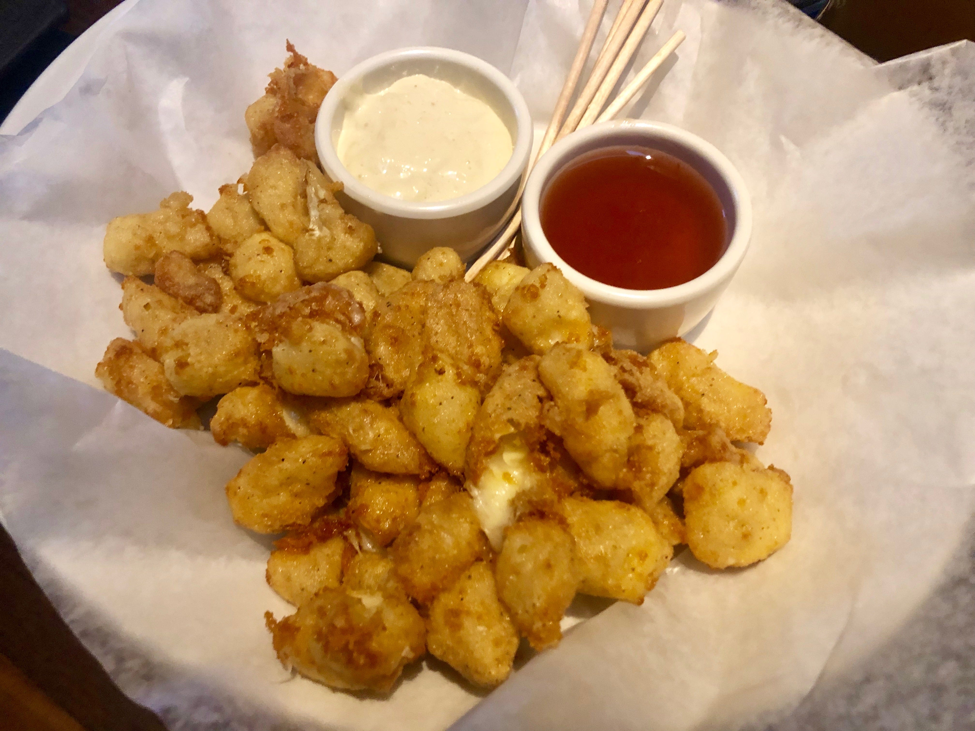 Gobs of fried  Wisconsin cheese curds come with honey hot sauce and horseradish aioli for dipping.