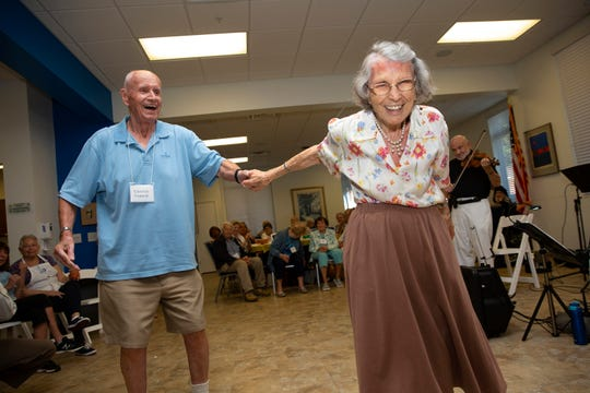 Clarence Venecek dances with Sylvia Berg as she celebrates her 104th birthday Wednesday, Feb. 27, 2019, at the Naples Senior Center.