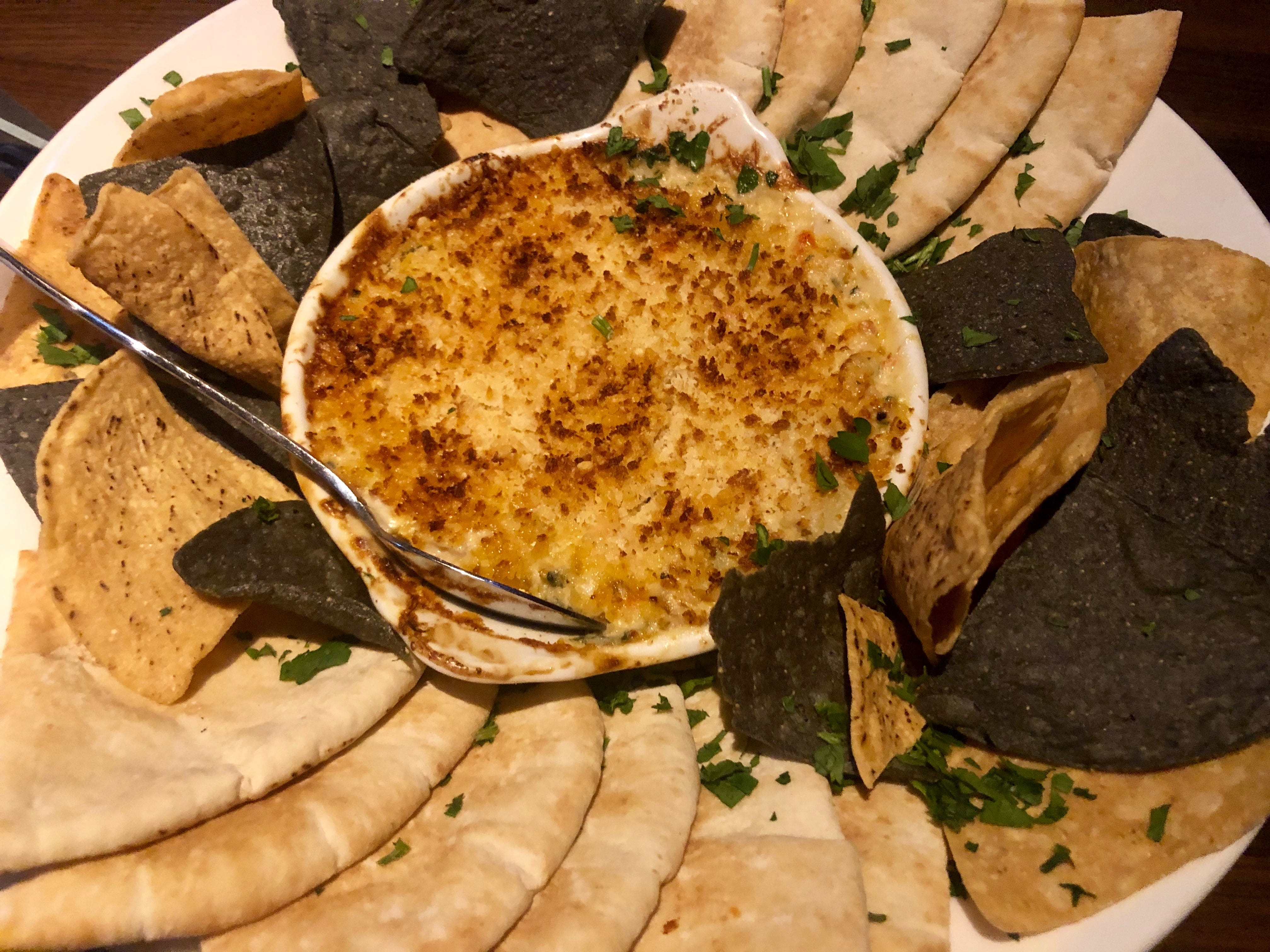 Lobster, crab and artichoke dip is warmly satisfying at Yard House in Naples.