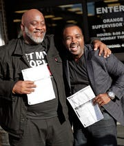 Former felons Desmond Meade, president of the Florida Rights Restoration Coalition, left, and David Ayala, husband of State Attorney Aramis Ayala, celebrate with copies of their voter registration forms after they registered at the Supervisor of Elections office Tuesday, Jan. 8, 2019, in Orlando, Fla. Former felons in Florida began registering for elections on Tuesday, when an amendment that restores their voting rights went into effect.