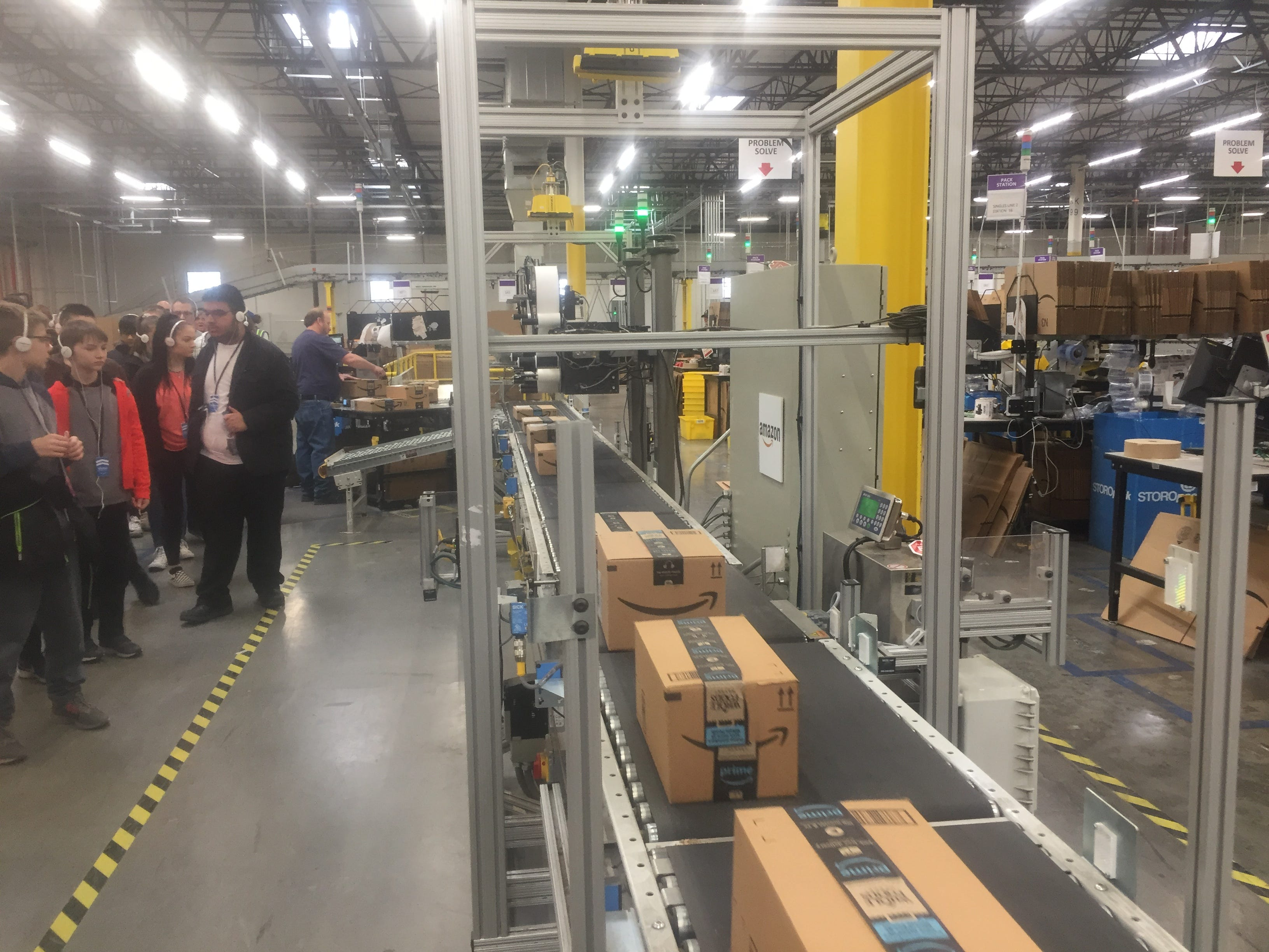 "The ""slam"" process, during which boxed items are weighed, labels printed and affixed for final delivery, is one of the last stops on the new public tours offered by the Etna Amazon facility."