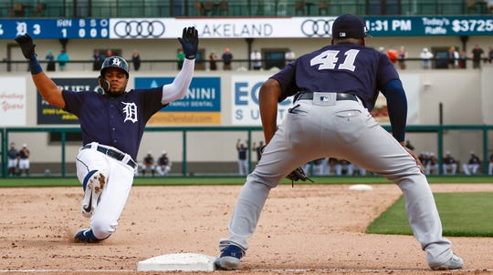 Feb 27, 2019; Lakeland, FL, USA; Detroit Tigers third baseman Jeimer Candelario (46) slides into third base as New York Yankees third baseman Miguel Andujar (41) looks on during the first inning at Publix Field at Joker Marchant Stadium.
