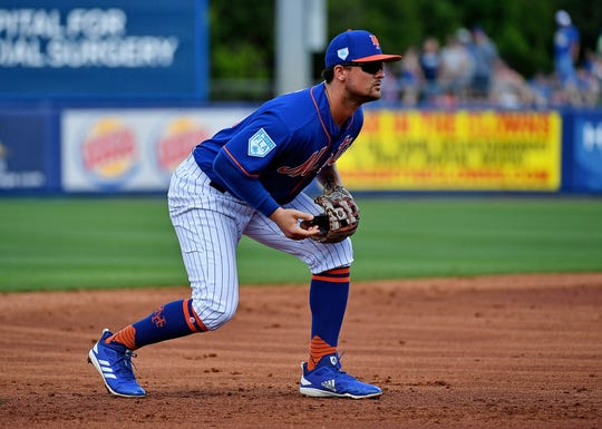 Feb 23, 2019; Port St. Lucie, FL, USA; New York Mets third baseman J.D. Davis (28) plays the field in the second inning of a spring training game against the Atlanta Braves at First Data Field.
