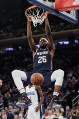 New York Knicks' Mitchell Robinson (26) dunks in front of Orlando Magic's Jonathan Isaac (1) during the second half of an NBA basketball game Tuesday, Feb. 26, 2019, in New York. The Knicks won 108-103. (AP Photo/Frank Franklin II)