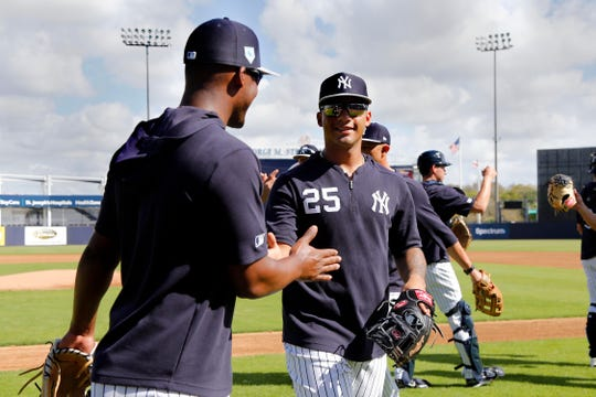 New York Yankees second baseman Gleyber Torres (25) and third baseman Miguel Andujar (41) high five as they workout at George M. Steinbrenner Field.