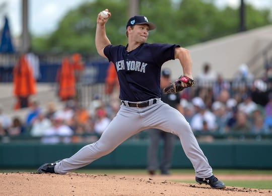 New York Yankees starting pitcher Chance Adams (43) throws a pitch during the first inning against the Detroit Tigers at Publix Field at Joker Marchant Stadium.